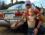 Gordon Minyard with boy and antlers